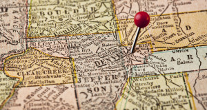 Denver on vintage 1920s map of Colorado with a red pushpin, selective focus (printed in 1926 - copyrights expired)